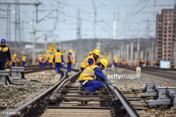 This photo taken on March 19 2019 shows employees working at the construction site of the TangshanHohhot railway in Ulanqab north China's Inner...