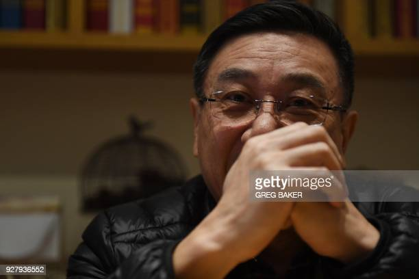 This photo taken on March 2 2018 shows Li Datong the former editor of the stateowned China Youth Daily newspaper speaking during an interview in...