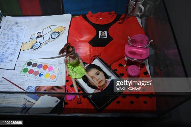 This photo taken on March 2 2020 shows a memory box of an Afghan child victim of conflict with her doll she played with before she was killed at the...