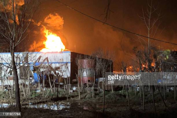 This photo taken on March 21 2019 shows fire and smoke rising following an explosion at a chemical plant in Yancheng in China's eastern Jiangsu...
