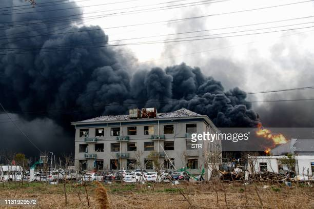 This photo taken on March 21 2019 shows fire and smoke rising at an explosion site in Yancheng in China's eastern Jiangsu province The death toll...