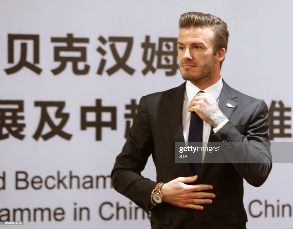This photo taken on March 23, 2013 shows English football superstar David Beckham attending a promotional event at the Zall Football Club in Wuhan, in central China's Wuhan province. Beckham raised the prospect of one last stop on his global football journey on March 20, refusing to rule out playing in China after his contract with Paris Saint-Germain ends. CHINA