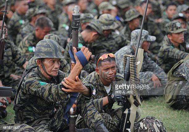 This photo taken on March 27 2014 shows Moro Islamic Liberation Front rebels attending a rally in support of the peace agreement with the government...