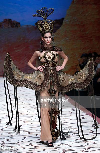 This photo taken on March 27 2016 shows a model parading a creation from Tao LouLan Collection designed by Tao Tao at China Fashion Week in Beijing /...
