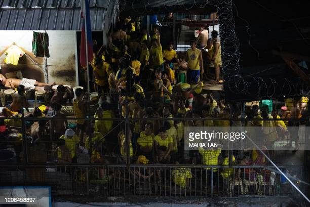 This photo taken on March 27 2020 shows prison inmates at the crowded courtyard of the Quezon City jail in Manila UN rights chief Michelle Bachelet...