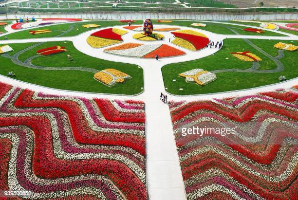 This photo taken on March 28 2018 shows an aerial view of a park decorated with different coloured flowers in Nantong in China's Jiangsu province /...