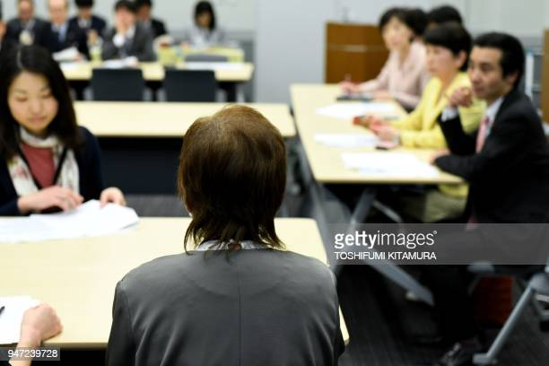 This photo taken on March 29 2018 shows Junko Iizuka who was sterilised at the age for 16 delivering her message during a meeting with lawmakers in...