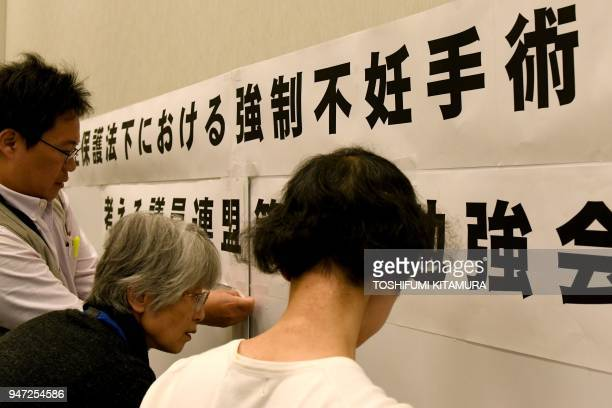 This photo taken on March 29 2018 shows supporters of victims of Japan's 'eugenics' programme preparing for a meeting with lawmakers in Tokyo...