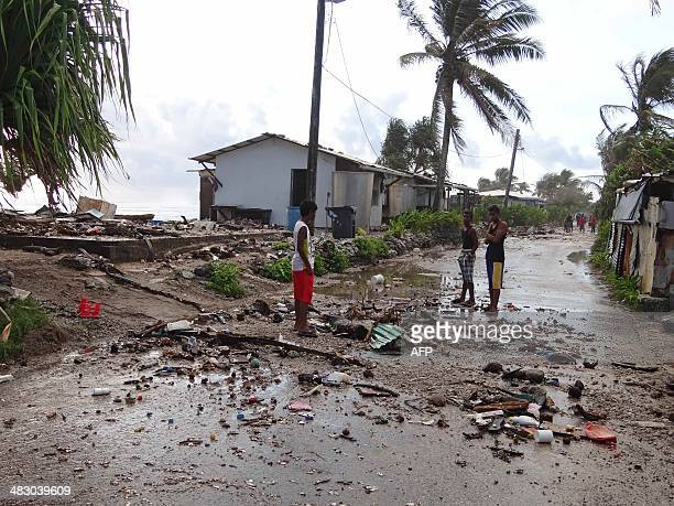 This photo taken on March 3 2014 shows residents looking at debris washed up and dumped across lowlying Majuro Atoll in the aftermath of a king tide...