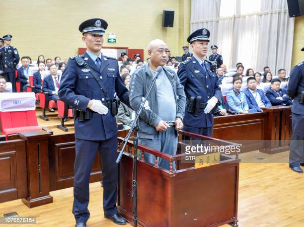This photo taken on March 30 2018 shows Gao Chengyong in the Baiyin Intermediate People's Court in Baiyin in China's northwestern Gansu province A...