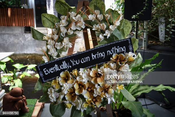 This photo taken on March 30 shows a traditional Thai funeral wreath at the Kid Mai Death Awareness Cafe an exhibition space built to educate the...