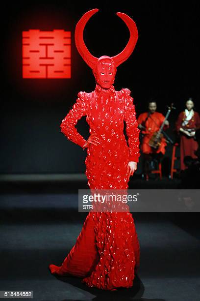 This photo taken on March 31 2016 shows a model parading a creation from the Sheguang Hu Collection designed by Hu Sheguang at China Fashion Week in...