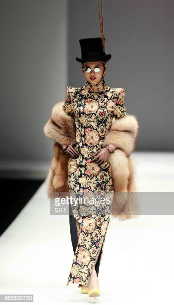 This photo taken on March 31 2017 shows a model displaying a creation from life as barbie from the Hu Sheguang Collection designed by Hu Sheguang at...