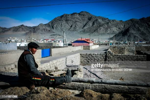 This photo taken on March 4, 2014 shows a man in the center of Bayan-Ulgii, in Ulgii soum, in Mongolia. - A Mongolian couple has died of the bubonic...