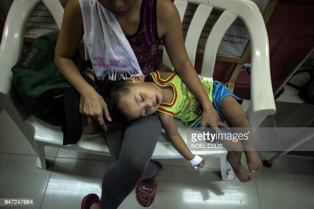 This photo taken on March 5 2018 shows dengue patient Kyle Valdez who has not been injected with the antidengue fever vaccine Dengvaxia with his...