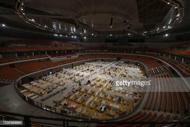 TOPSHOT This photo taken on March 5 2020 shows a temporary hospital set up for COVID19 coronavirus patients in a sports stadium in Wuhan in China's...
