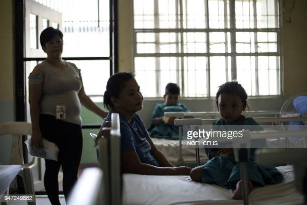This photo taken on March 5 shows dengue patients who have not injected with the antidengue fever vaccine Dengvaxia at the Dengue Ward at the East...