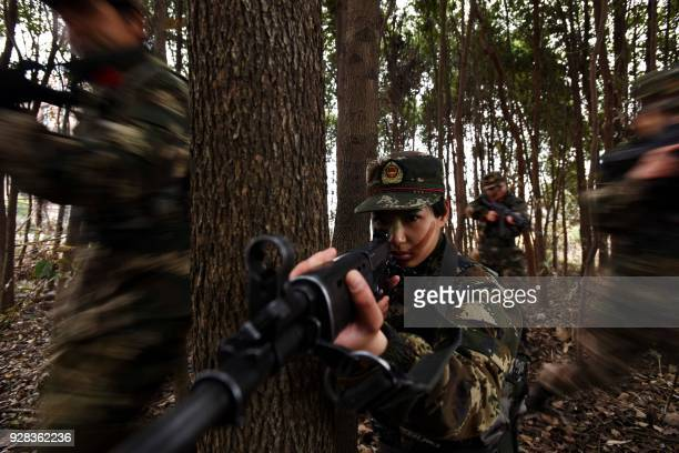 This photo taken on March 6, 2018 shows female members of China's paramilitary police taking part in a drill ahead of International Women's Day in...