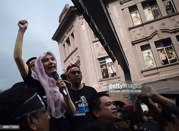 This photo taken on March 7 2015 shows Nurul Izzah the daughter of jailed Malaysian opposition leader Anwar Ibrahim addressing a protest march...