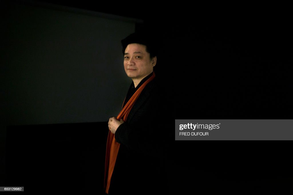 This photo taken on March 7, 2017 shows Chinese television host and producer Cui Yongyuan posing in Beijing. Empty talk, self-censorship, brain-dead conformity -- that's outspoken delegate Cui Yong...