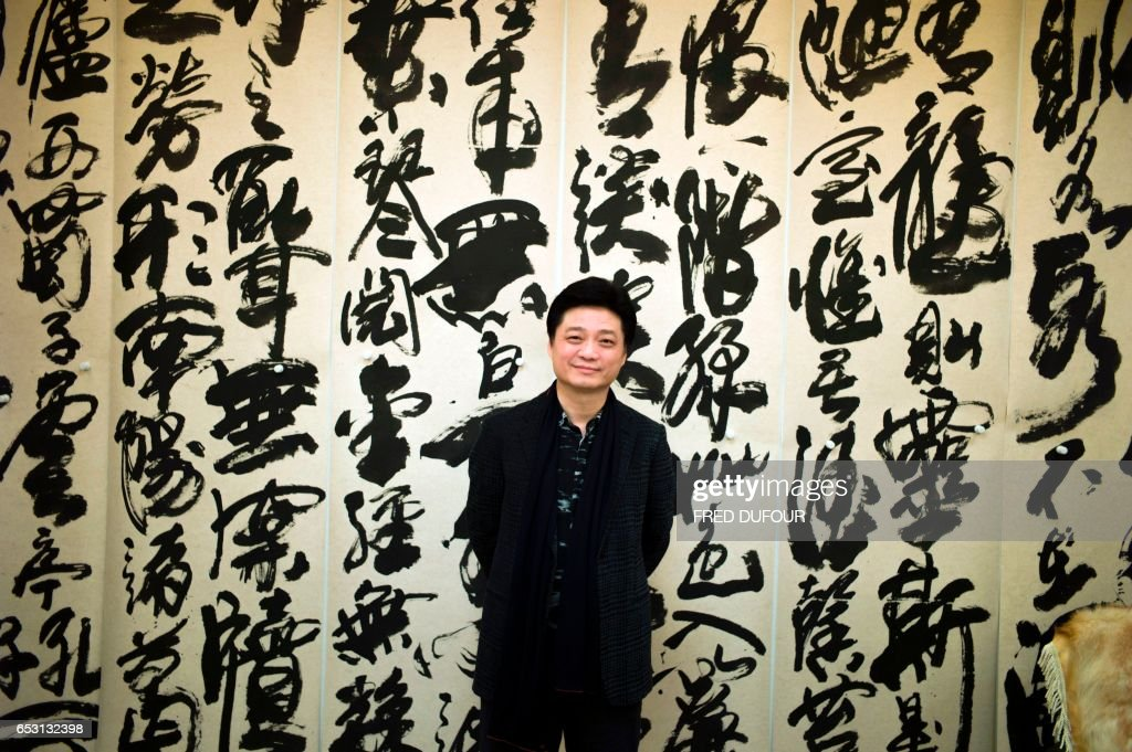 This photo taken on March 7, 2017 shows Chinese television host and producer Cui Yongyuan posing at his workshop in Beijing. Empty talk, self-censorship, brain-dead conformity -- that's outspoken d...