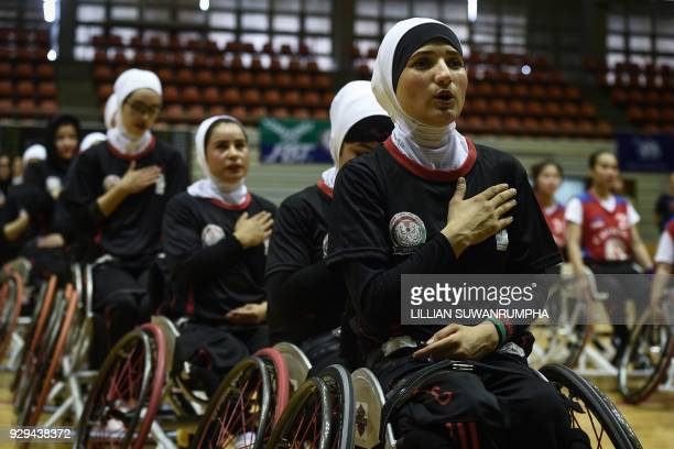 This photo taken on March 7, 2018 shows members of Afghanistan's women's wheelchair basketball team singing their national anthem during the...