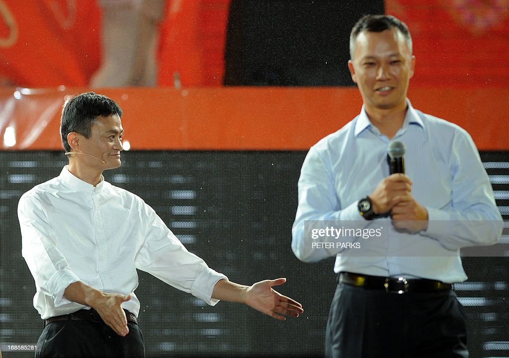 This photo taken on May 10, 2013 shows Alibaba founder Jack Ma (L) introducing new CEO Lu Zhaoxi (R) at an event to mark the 10th anniversary of China's most popular online shopping destination Taobao Marketplace, in the eastern Chinese city of Hangzhou. Alibaba chief Jack Ma stepped down on May 10 before a potential initial public offering as the Chinese online retail giant announced a 294 million USD stake purchase in digital mapping firm AutoNavi. AFP PHOTO / Peter PARKS