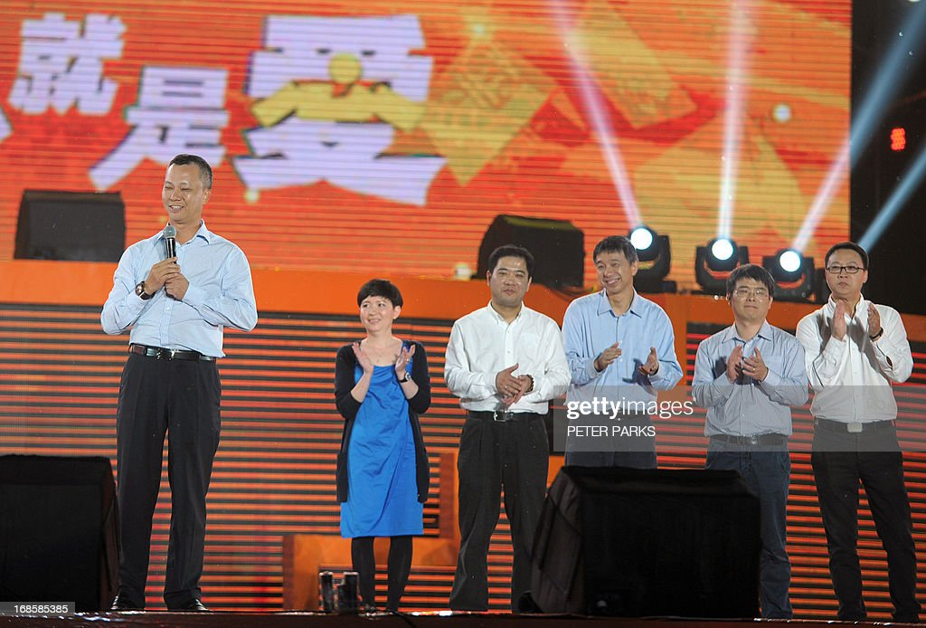 This photo taken on May 10, 2013 shows the new CEO of Alibaba, the world's largest online retailer, Lu Zhaoxi (L), speaking at an event to mark the 10th anniversary of China's most popular online shopping destination Taobao Marketplace, in the eastern Chinese city of Hangzhou. Alibaba chief and founder Jack Ma stepped down on May 10 before a potential initial public offering as the Chinese online retail giant announced a 294 million USD stake purchase in digital mapping firm AutoNavi. AFP PHOTO / Peter PARKS