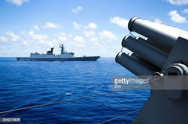 This photo taken on May 10 2016 shows crew members of China's South Sea Fleet taking part in a logistics supply drill near the James Shoal area on...