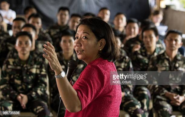 This photo taken on May 11 2018 shows journalist Rowena Paraan speaking during a lecture about fake news in Philippine Army Camp Jaime Bitong in...
