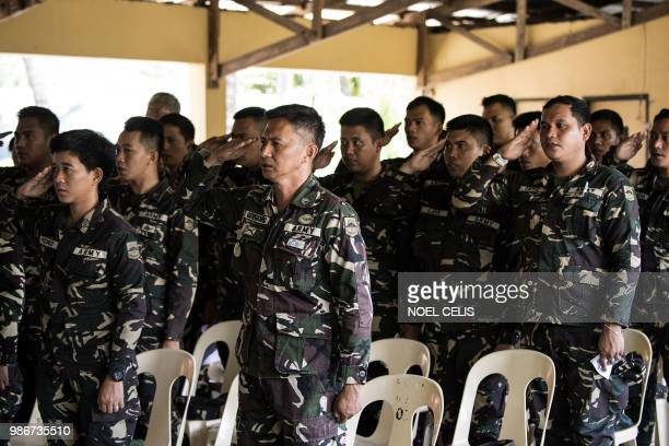 This photo taken on May 11 2018 shows Philippine soldiers singing the national anthem befiore a fake news lecture in Philippine Army Camp Jaime...