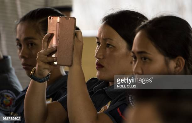 This photo taken on May 11 2018 shows police officers attending a lecture about fake news in Philippine Army Camp Jaime Bitong in Baler Aurora north...