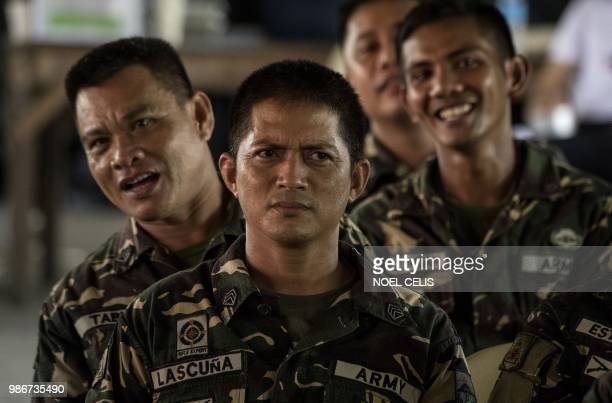 This photo taken on May 11 2018 shows soldiers attending a lecture about fake news in Philippine Army Camp Jaime Bitong in Baler Aurora north of...