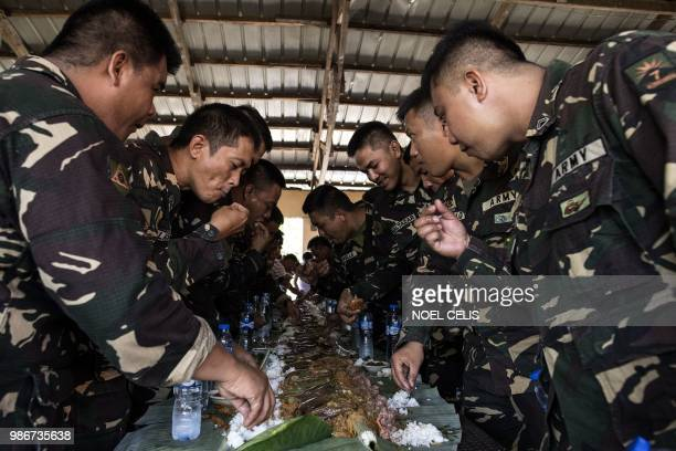 This photo taken on May 11 2018 shows soldiers having a lunch break during a lecture about fake news in Philippine Army Camp Jaime Bitong in Baler...