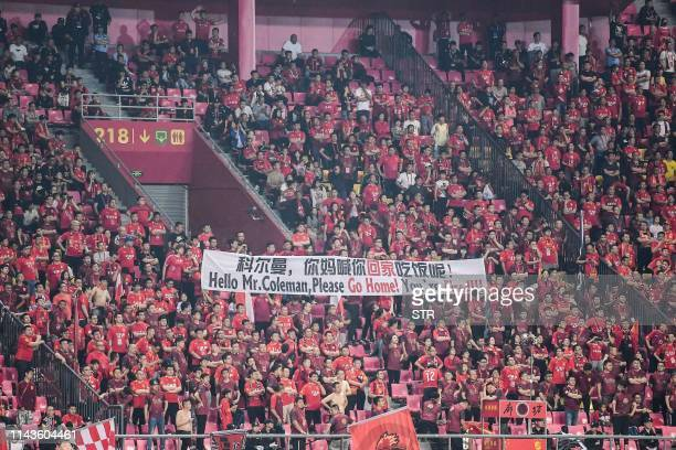 This photo taken on May 11 2019 shows fans of Hebei China Fortune FC holding a banner that read Hello Mr Coleman please go home You're fired during...