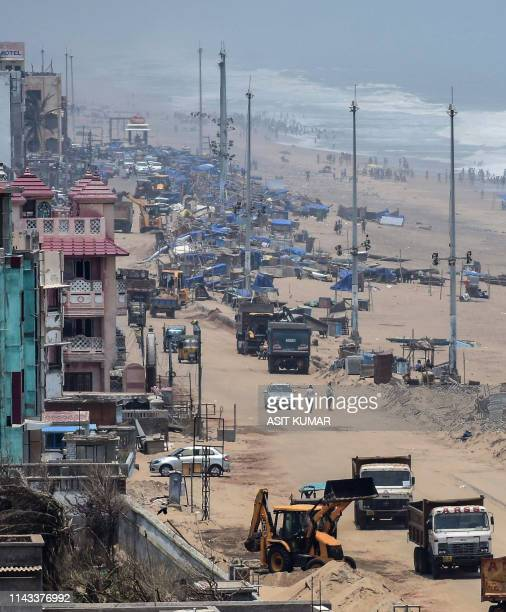 This photo taken on May 12 2019 shows a cleanup operation to repair beach side hotels and coastal facilities in Puri in the eastern Indian state of...
