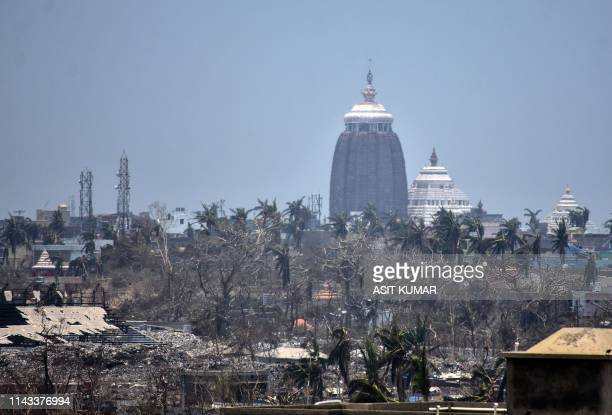 TOPSHOT This photo taken on May 12 2019 shows the Lord Jagannath temple amid destroyed trees and debris in Puri in the eastern Indian state of Odisha...