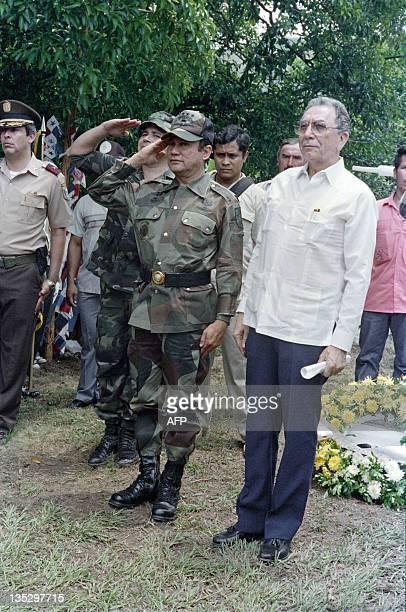 This photo taken on May 13, 1988 in La Negrita shows General Manuel Antonio Noriega next to Panama's President Manuel Solis Palma , saluting during...