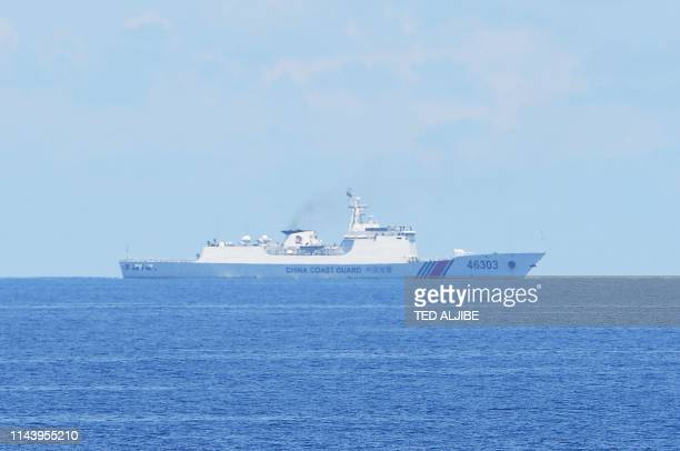 This photo taken on May 14 Chinese coastguard ship monitors during the joint search and rescue exercise between Philippine and US coastguards near...