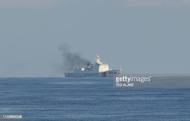 This photo taken on May 14 Chinese coastguard ship sails along the area of the joint search and rescue exercise between Philippine and US coastguards...