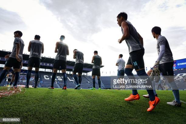"""This photo taken on May 17, 2017 shows Buriram United football players warming up before a Thai Premier League match at the i-Mobile """"Thunder Castle""""..."""