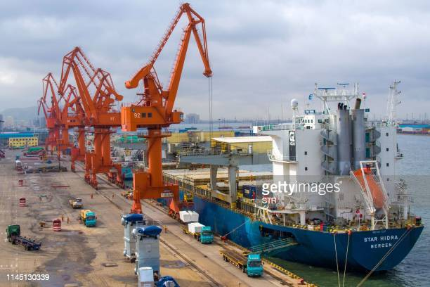 This photo taken on May 17 2019 shows a ship unloading at the port in Qingdao in China's eastern Shandong province EU firms are caught in the...