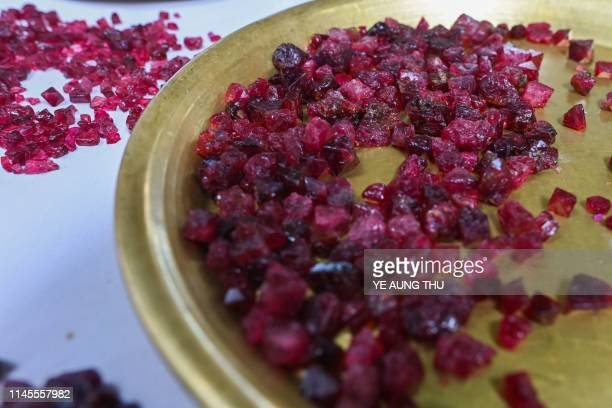 This photo taken on May 17 2019 shows rough rubies displayed at the gems market in Mogok town north of Mandalay Burrowing deep underground thousands...