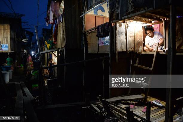 This photo taken on May 18 2016 shows a resident doing her house chores at an informal settler area in Davao City in southern island of Mindanao...