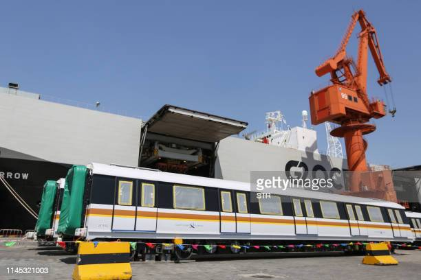 This photo taken on May 20, 2019 shows automated urban subway cars waiting to be exported to Singapore at a port in Qingdao, in China's eastern...