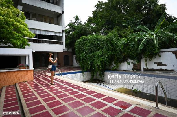 This photo taken on May 20, 2021 shows Marcela Casaren, a Brazilian resident in Thailand, taking pictures and videos around the Baan Bellawin...