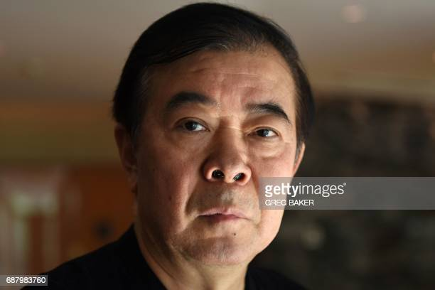 This photo taken on May 21 2017 shows writer Zhou Meisen at his hotel during a visit to Beijing In the midst of China's Cultural Revolution a...