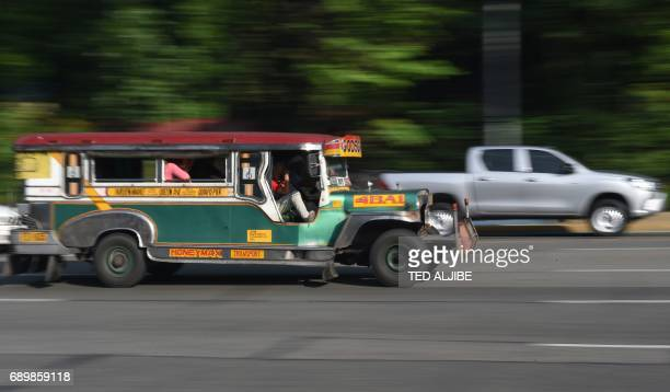 This photo taken on May 22 2017 shows a jeepney plying its route in Manila Jeepneys once hailed as the 'King of the Road' and a cultural symbol in...
