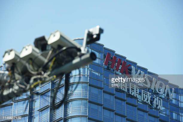 This photo taken on May 22, 2019 shows the Hikvision headquarters in Hangzhou, in east China's Zhejiang province. - Shares in two top Chinese...