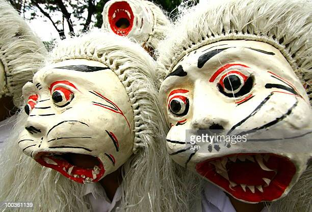 This photo taken on May 23 2010 Indonesian performers parade wearing masks during the traditional Topeng or mask festival in Malang East Java...